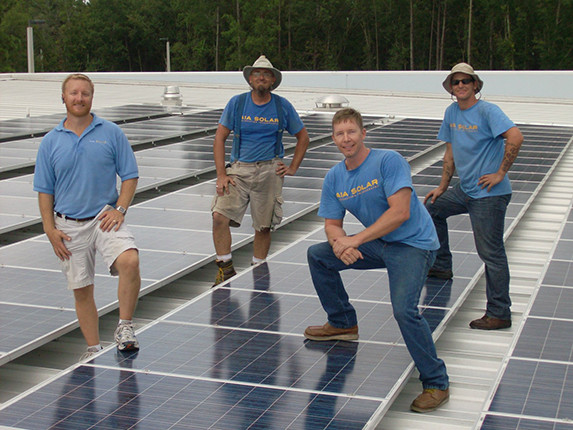 photovoltaic system and men on a roof