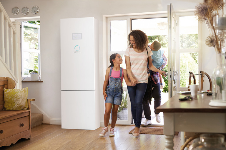 eco with family in home entryway