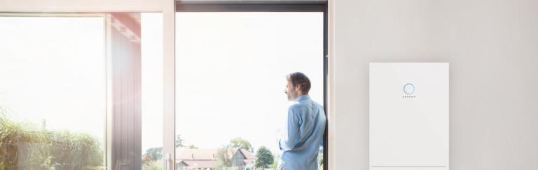 Man at window with sonnenBatterie hybrid