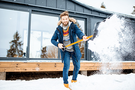 Man shoveling snow after a storm