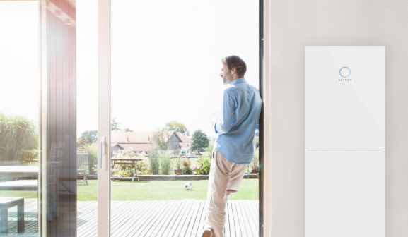 Man at window with sonnenBatterie hybrid
